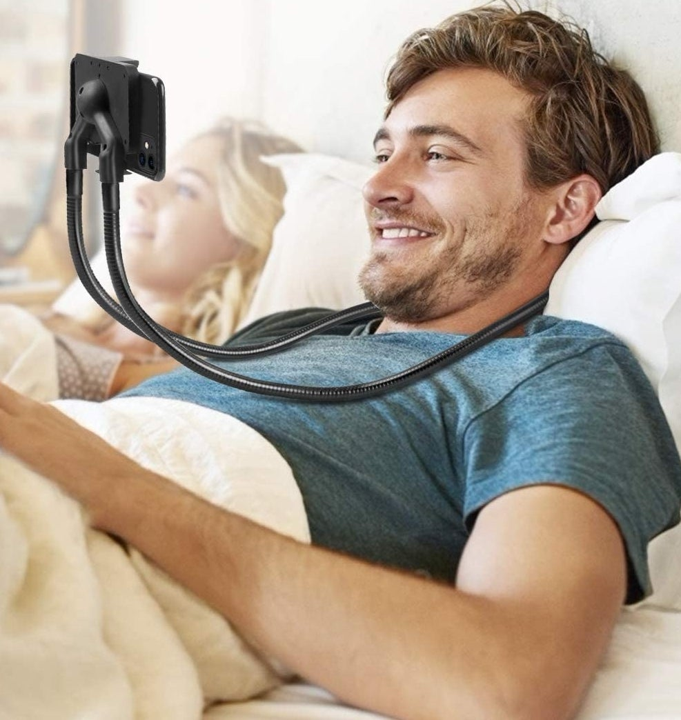 A person wearing the phone mount in bed