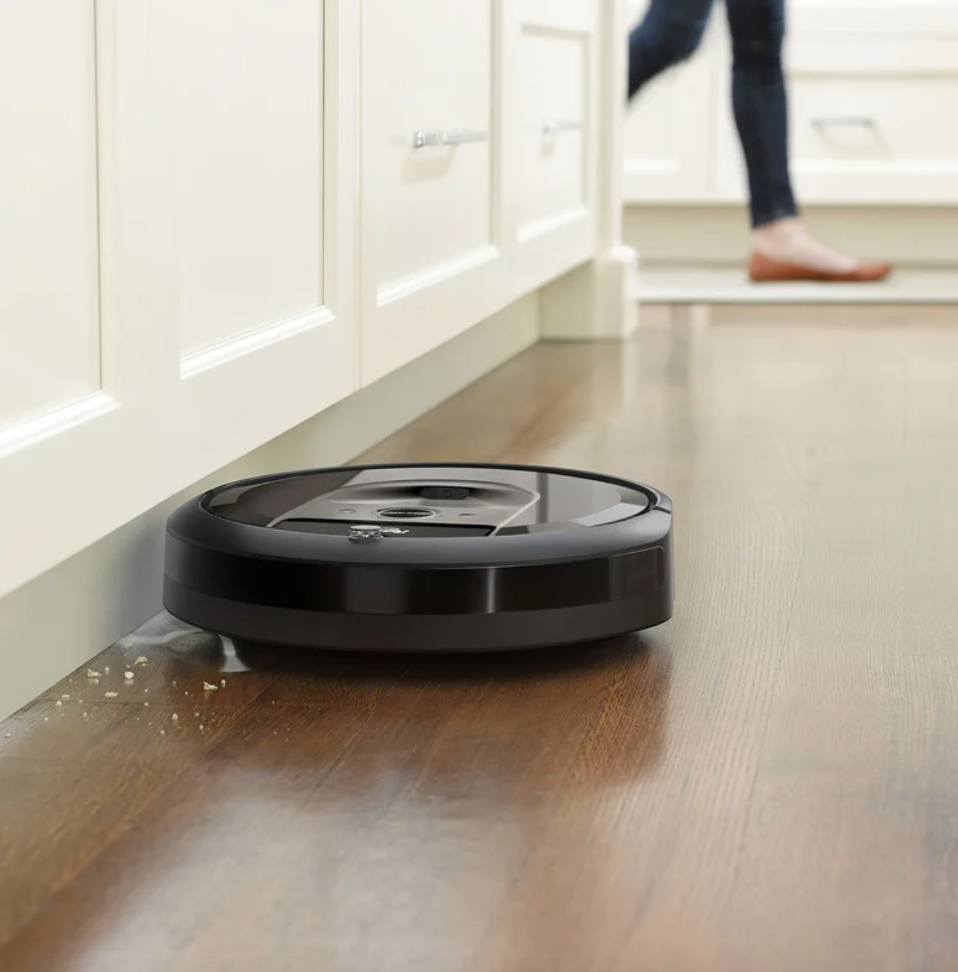 the robot vacuum cleaning up crumbs on the floor