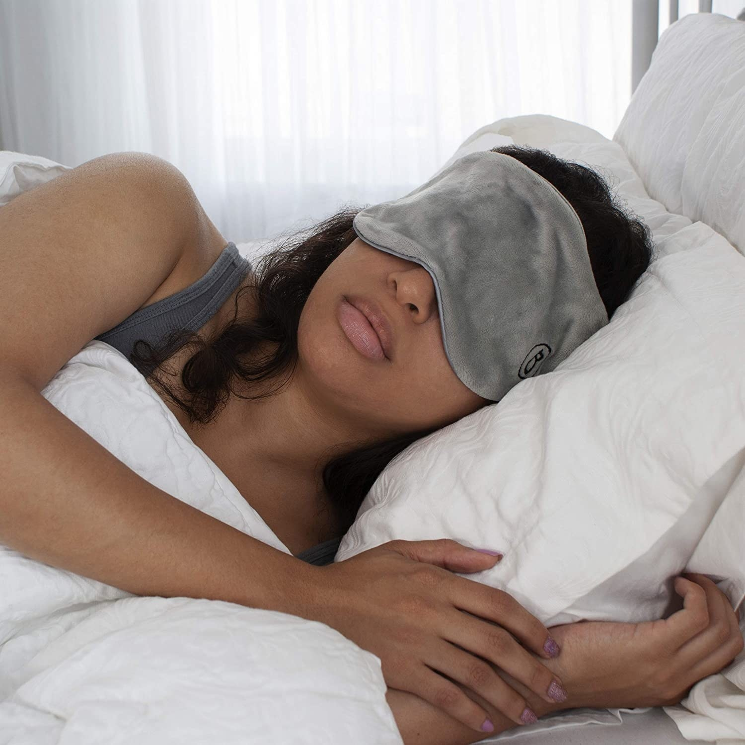A person sleeping with the mask on