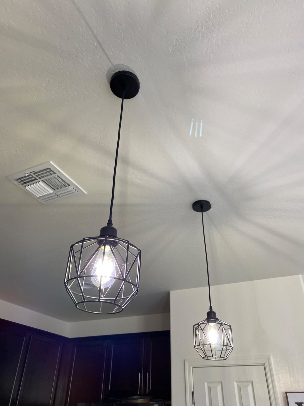 The hanging cage pendant lights