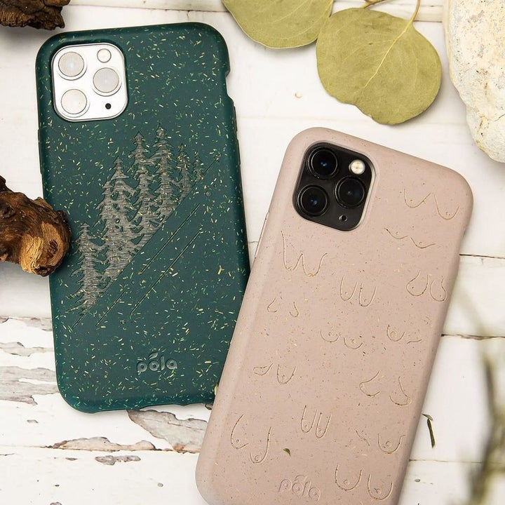 A green Pela iPhone case with a tree print and a tan Pela iPhone case with a boob print