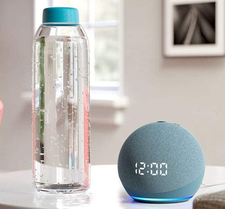 The Echo Dot next to a water bottle