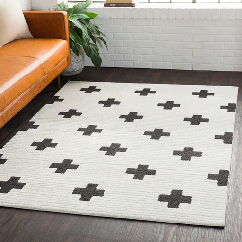 off white rug with black X design on it