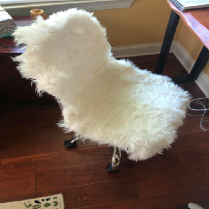 faux fur rug on a rolling office chair
