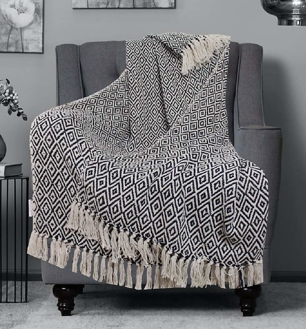 A grey throw blanket on a chair