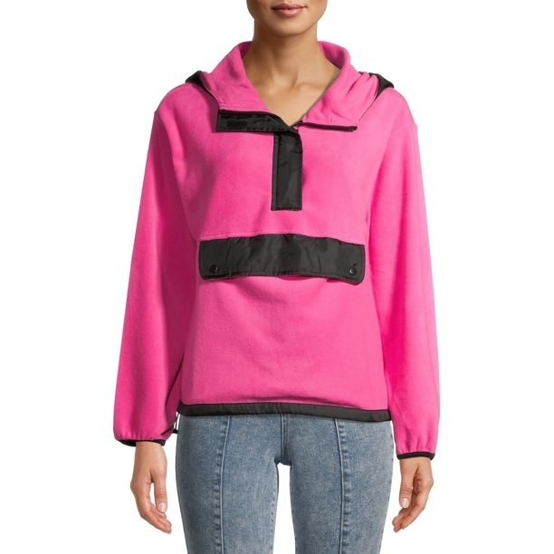 Model in pink long sleeve polar fleece