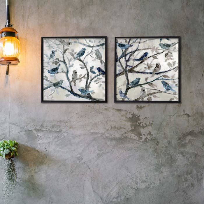 Two paintings of birds in dull blue and grey on a white base.