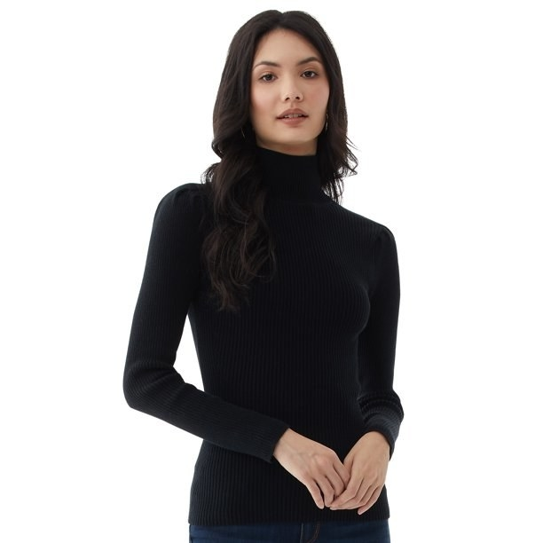 Model in puckered sleeve turtleneck sweater