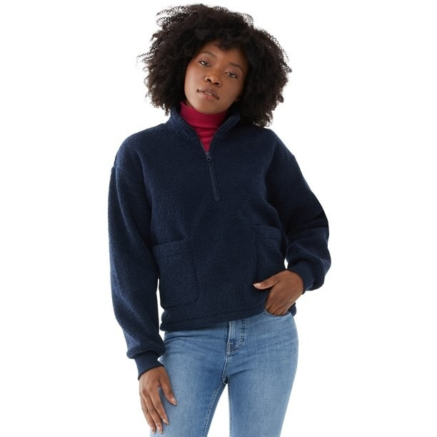 Model in half zip faux sherpa sweatshirt