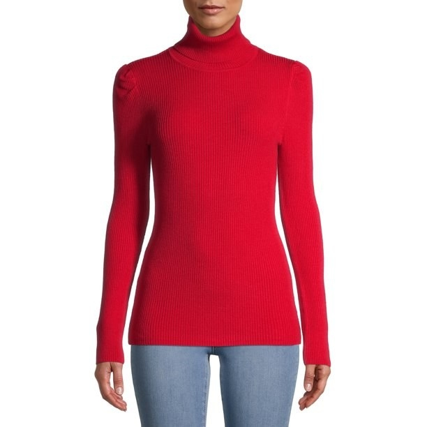 Model in red puff shoulder turtleneck sweater