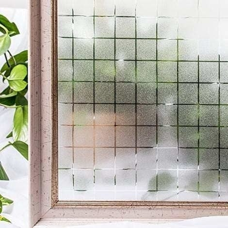 A window covered with checkered frosted film.