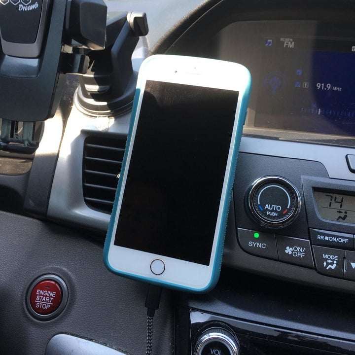 reviewer photo showing their iPhone attached to the magnetic mount