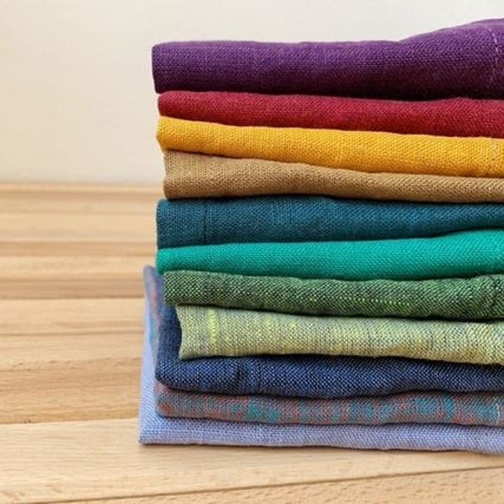 A stack of different-colored linen napkins