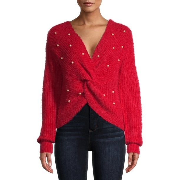 Model in red twist sweater with pearl accents