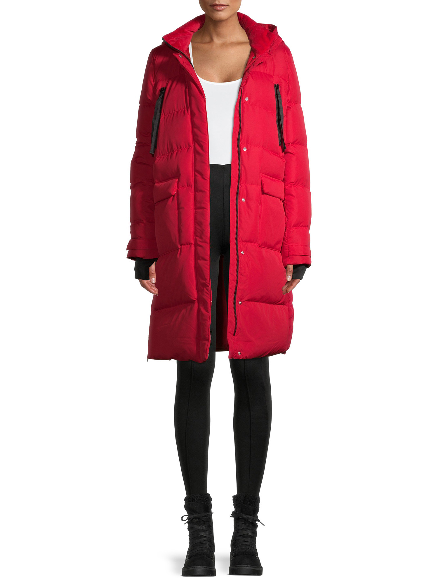 Model in ultra long down blend puffer coat with hood
