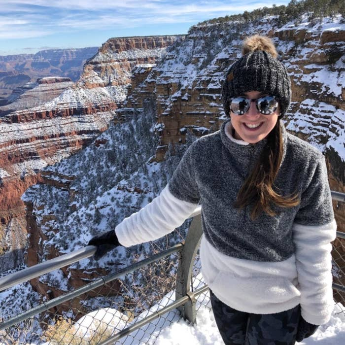 Reviewer wearing the pullover dark grey on the top and white on the bottom