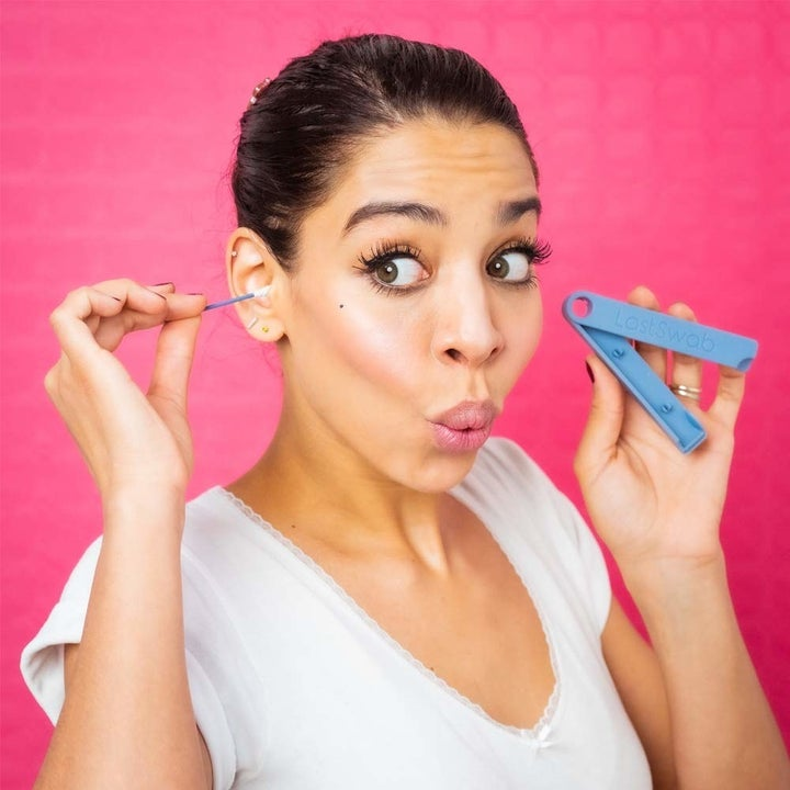 A model holding the LastSwab case and inserting the swab into their ear