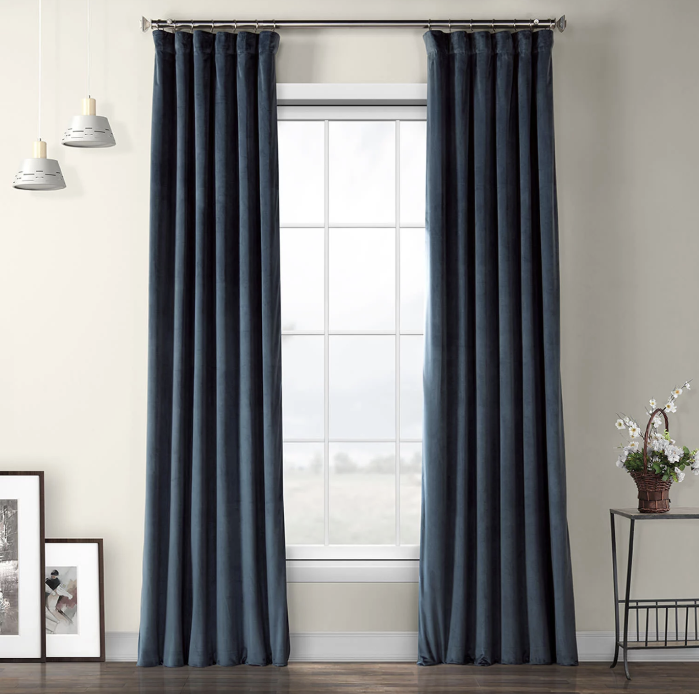 two avalon blue heritage plush velvet curtains hanging from a window