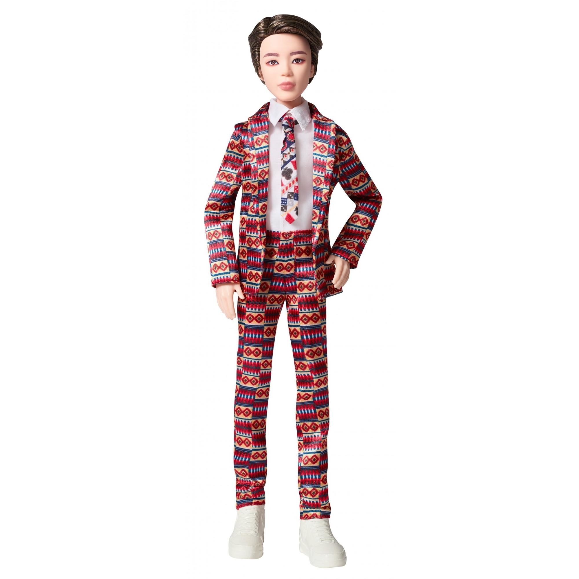 A doll in a multicolored suit