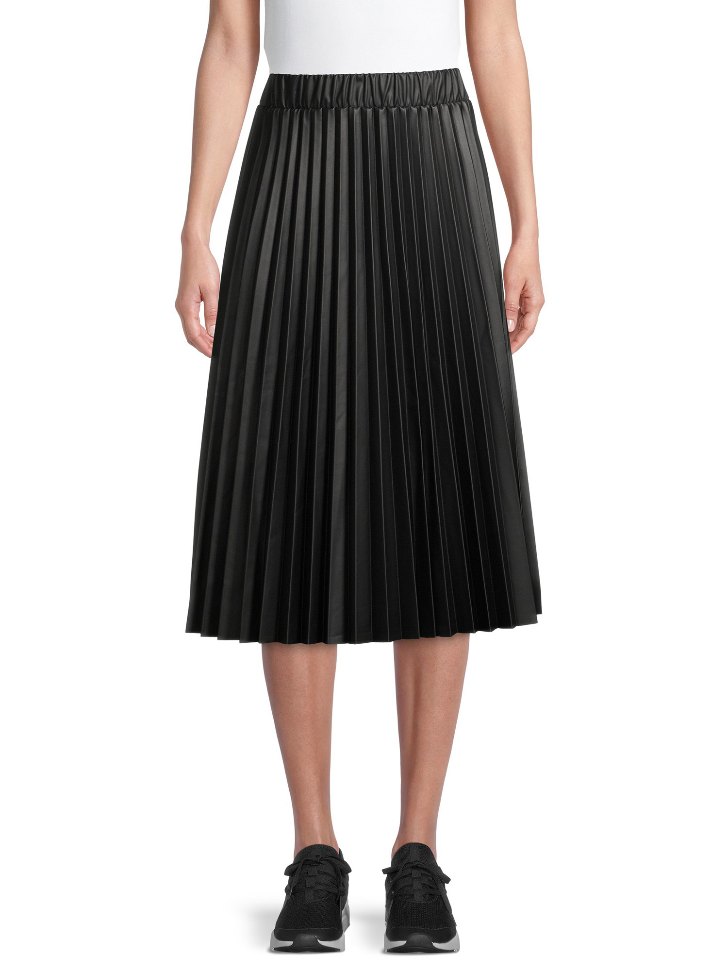 person wearing a faux leather midi skirt with a white t shirt and black tennis shoes