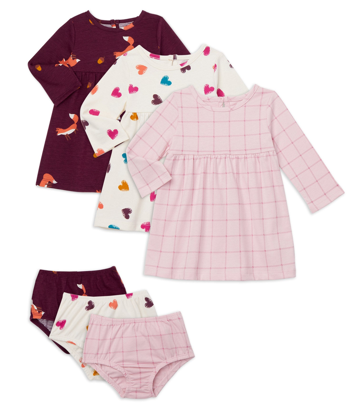 A set of three dresses and diaper covers in various patterns