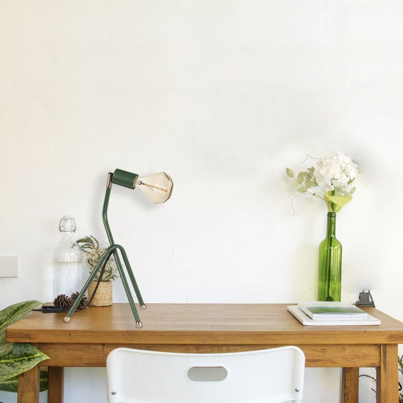 The green desk lamp on a desk