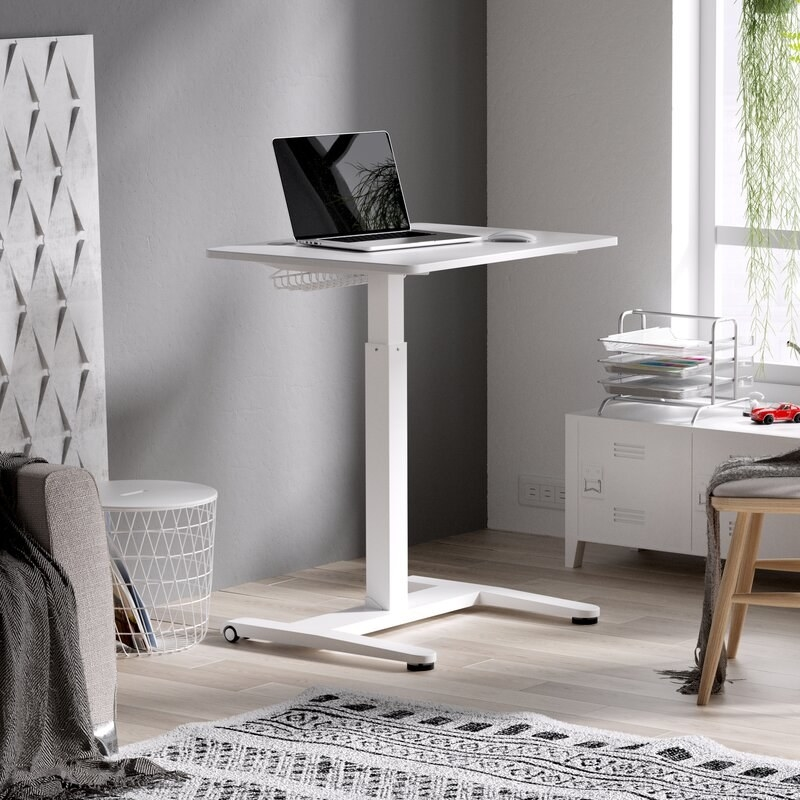 the ergobond compact standing desk in the corner of a living space