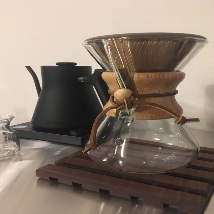 A pour-over coffee Chemex carafe with the reusable filter inserted at the top