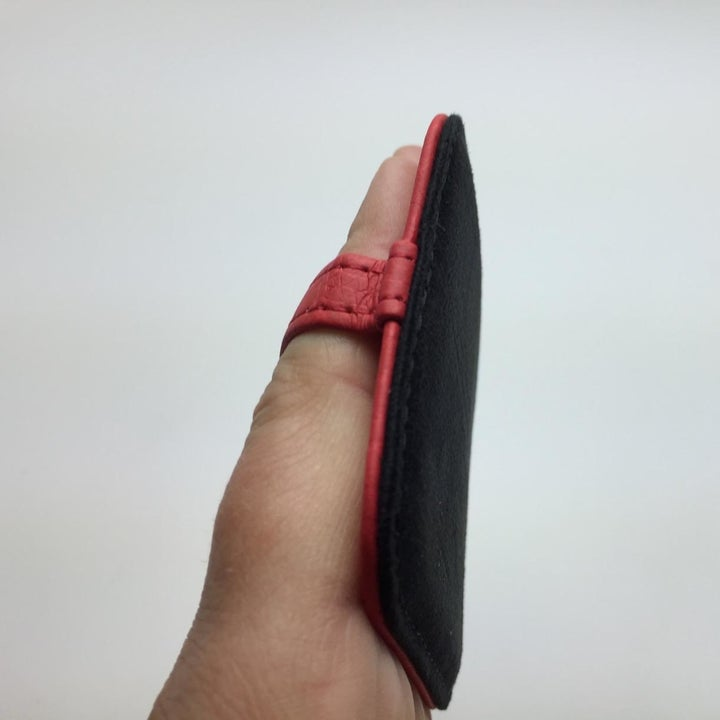 reviewer photo of person holding one of the cleaning pads on their fingers