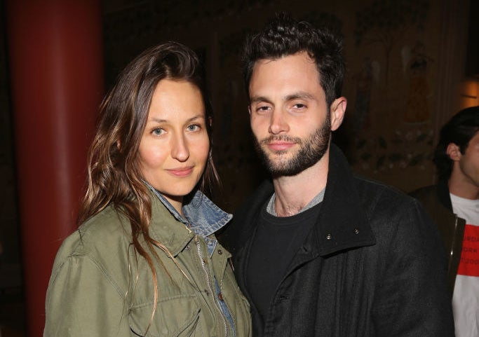 Domino Kirke and Penn Badgley posing next to one another