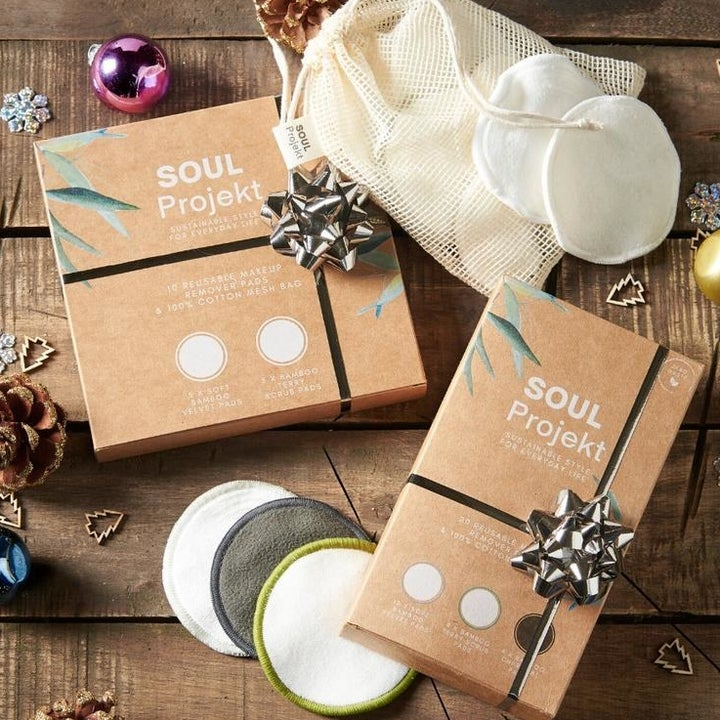 """Two wrapped presents that say """"Soul Projekt"""" sitting amongst a collection of reusable cotton pads"""