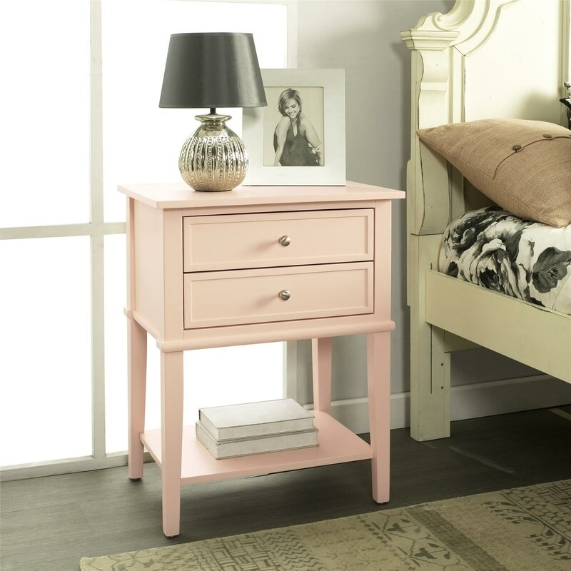 the pink beachcrest home two drawer nightstand next to a bed