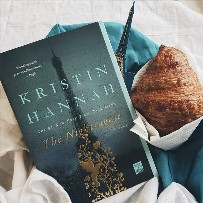 the book next to a croissant