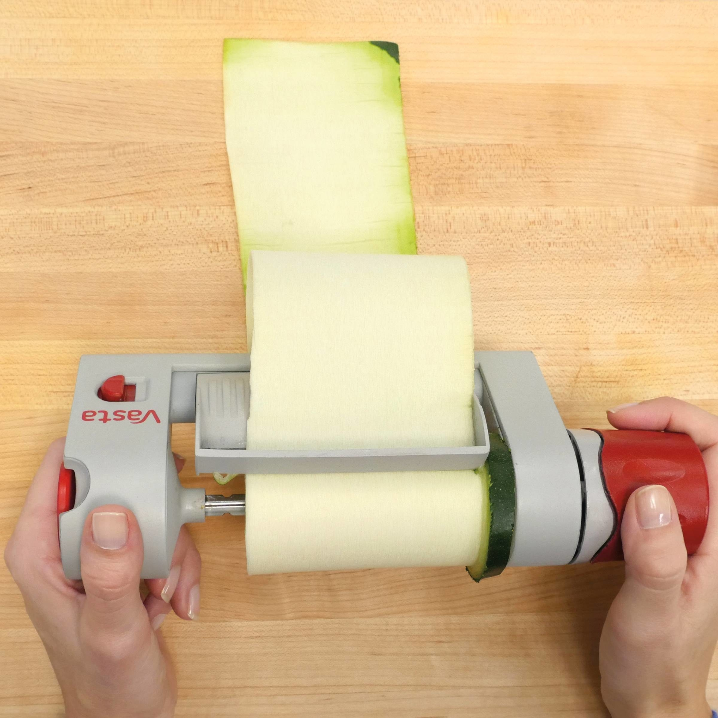 A model using the slicer to make a sheet of zucchini