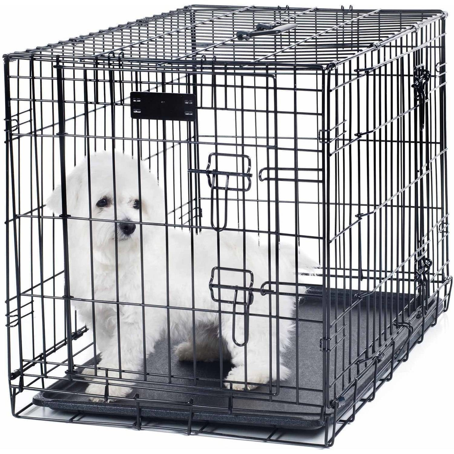black metal crate with a dog inside