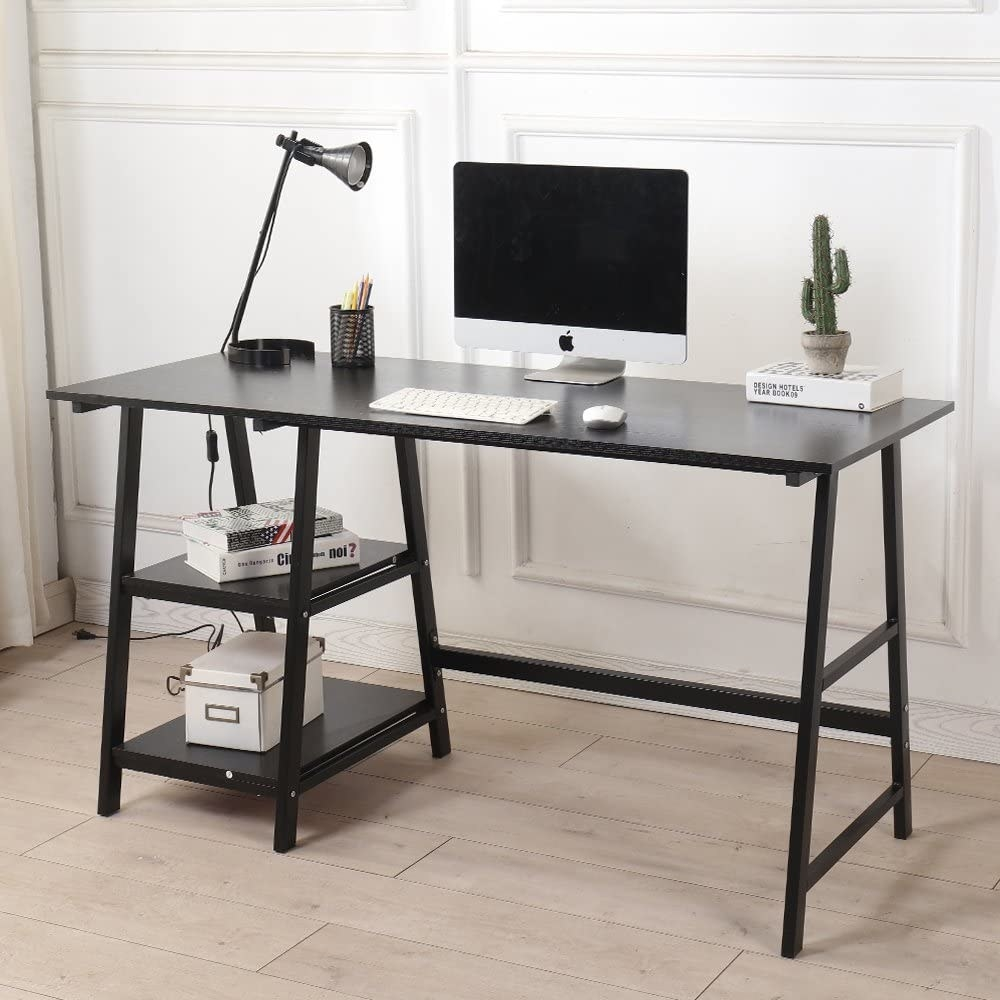 A small wooden desk with a computer monitor and lamp on the top There are two built-in shelves underneath with a small box on one