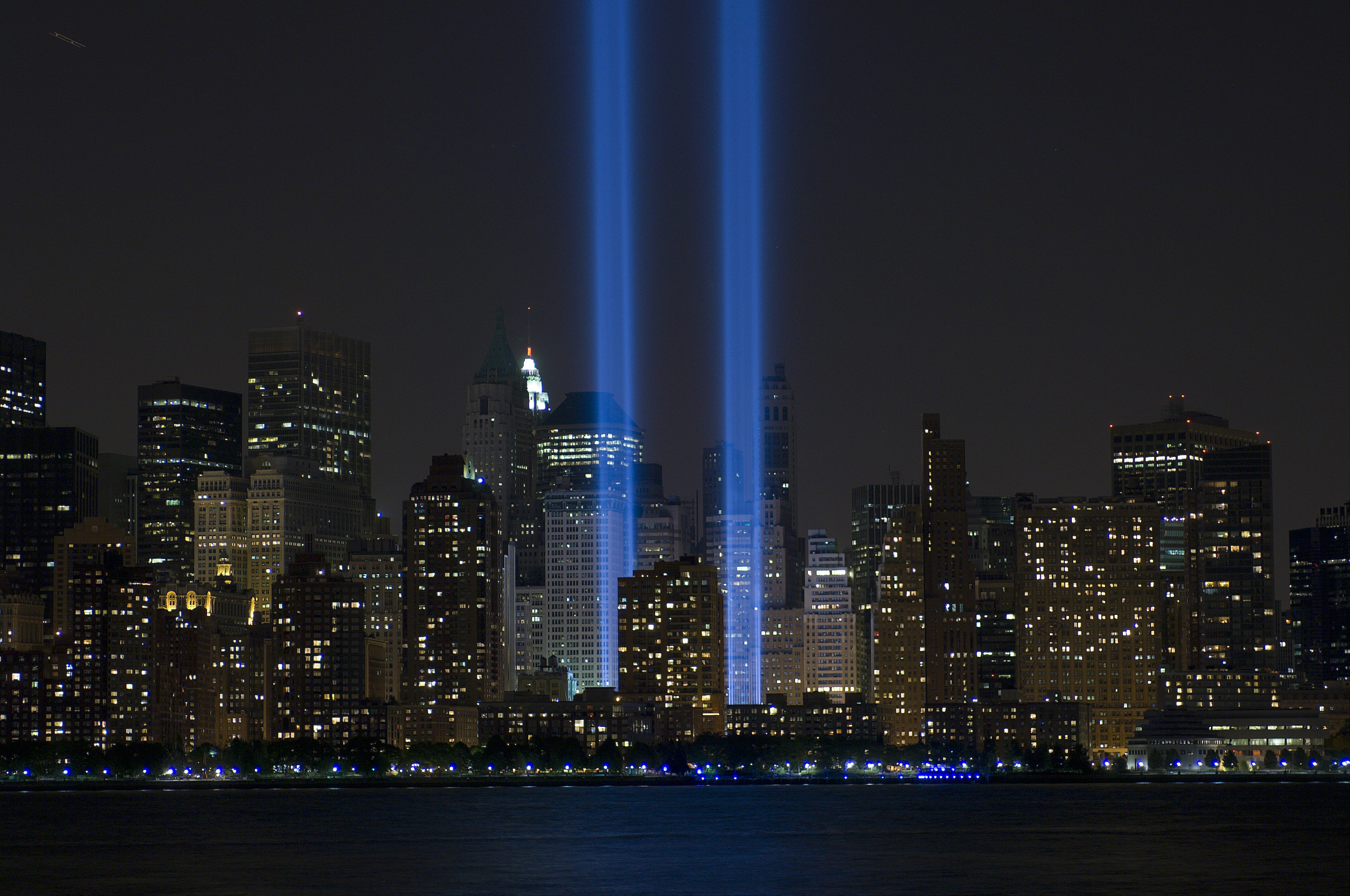 The 9/11 memorial lights shining where the Twin Towers used to stand