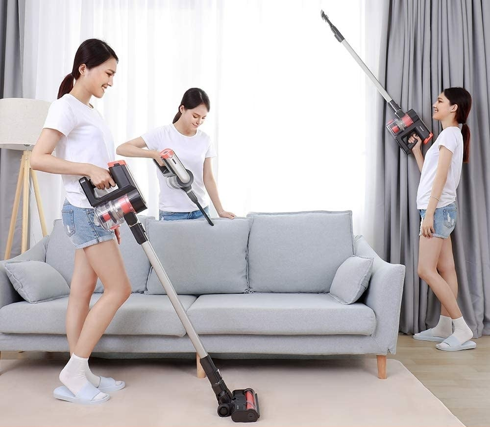 Someone vacuuming their living room with the cordless vacuum cleaner