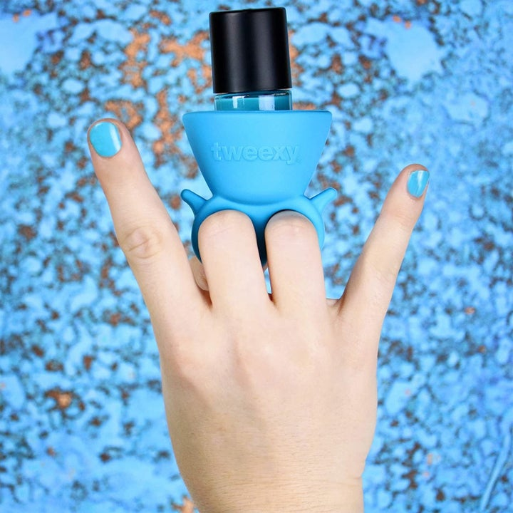 A model with the blue version showing how it connects on the hand from the side