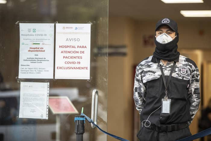 A man stands guard outside the covid ward of a hospital in Mexico City