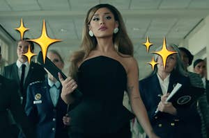 Ariana in the positions music video surrounded by sparkle emojis