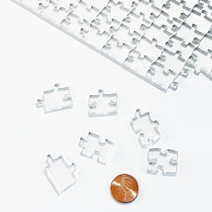 photo showing size of clear puzzle pieces is about the same as a penny