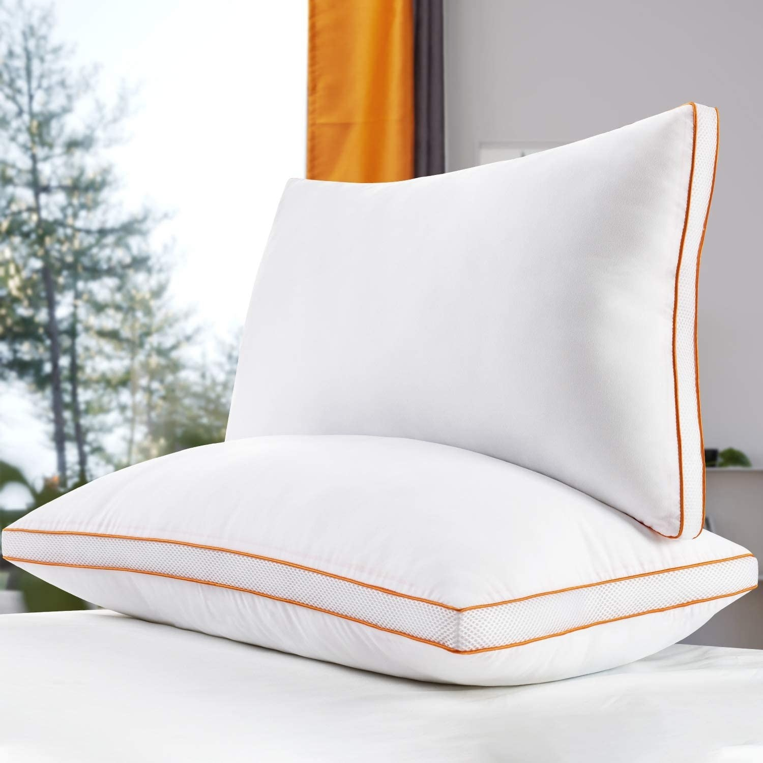 A pair of pillows stacked on top of one another with a forest in the background