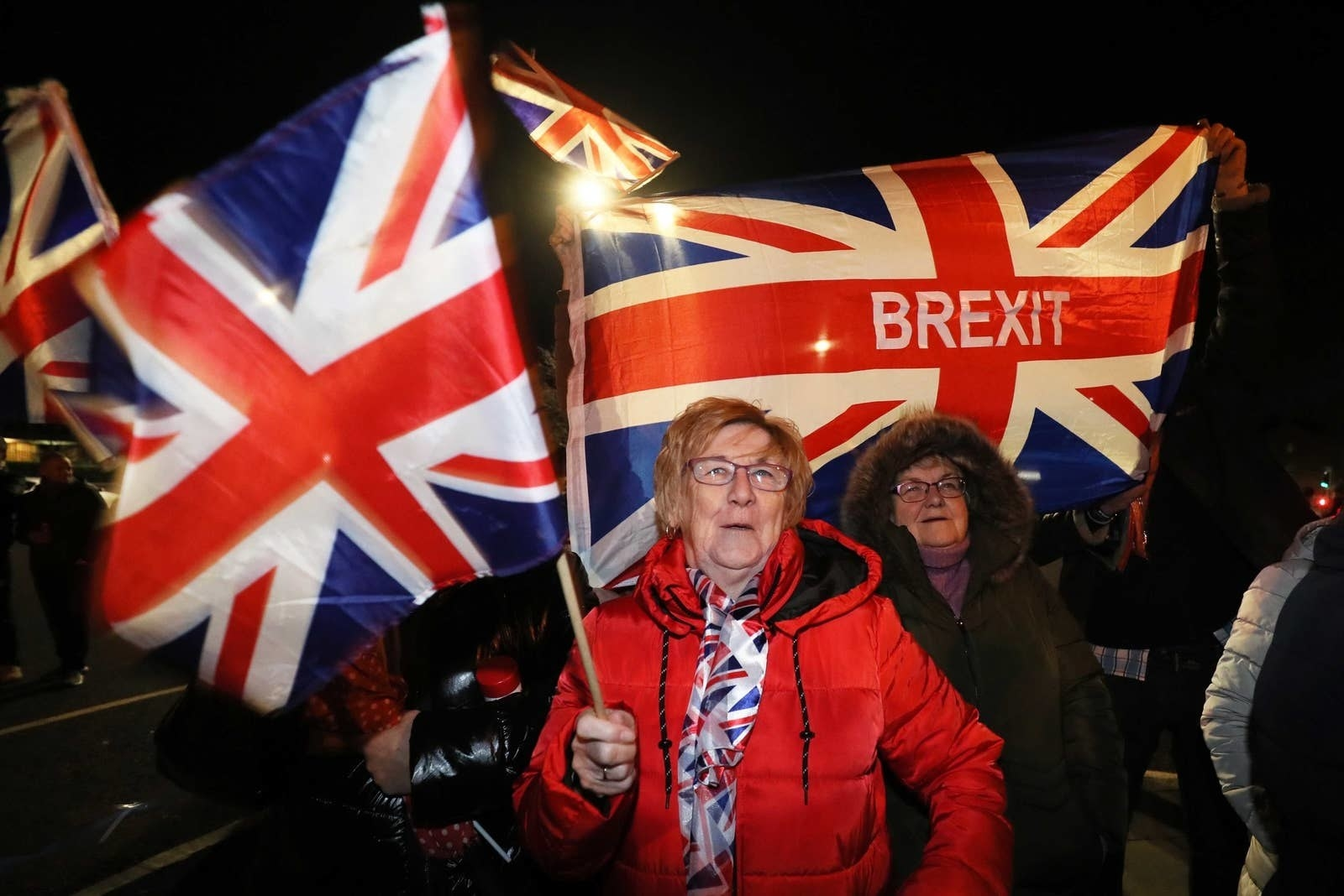 """Two women in front of UK flags, one of which reads """"BREXIT"""""""