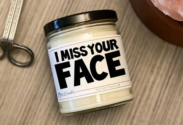 """the candle with a label that reads """"I miss your face"""""""