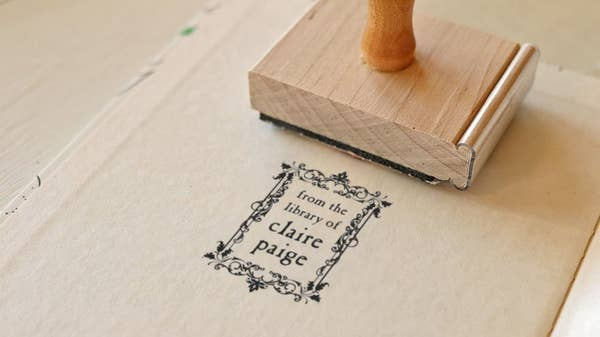 """the stamp that reads """"from the library of claire paige"""""""