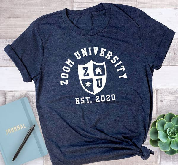 """The shirt in blue that reads """"Zoom University est 2020"""""""