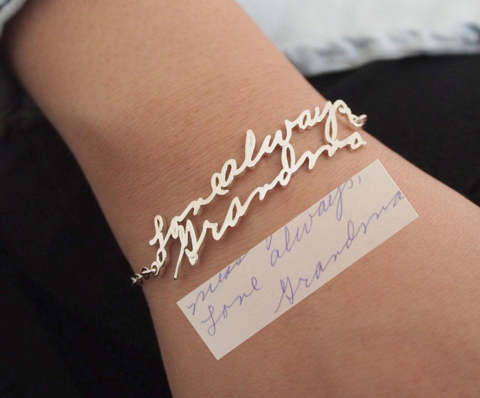 person wearing personalized handwritten bracelet