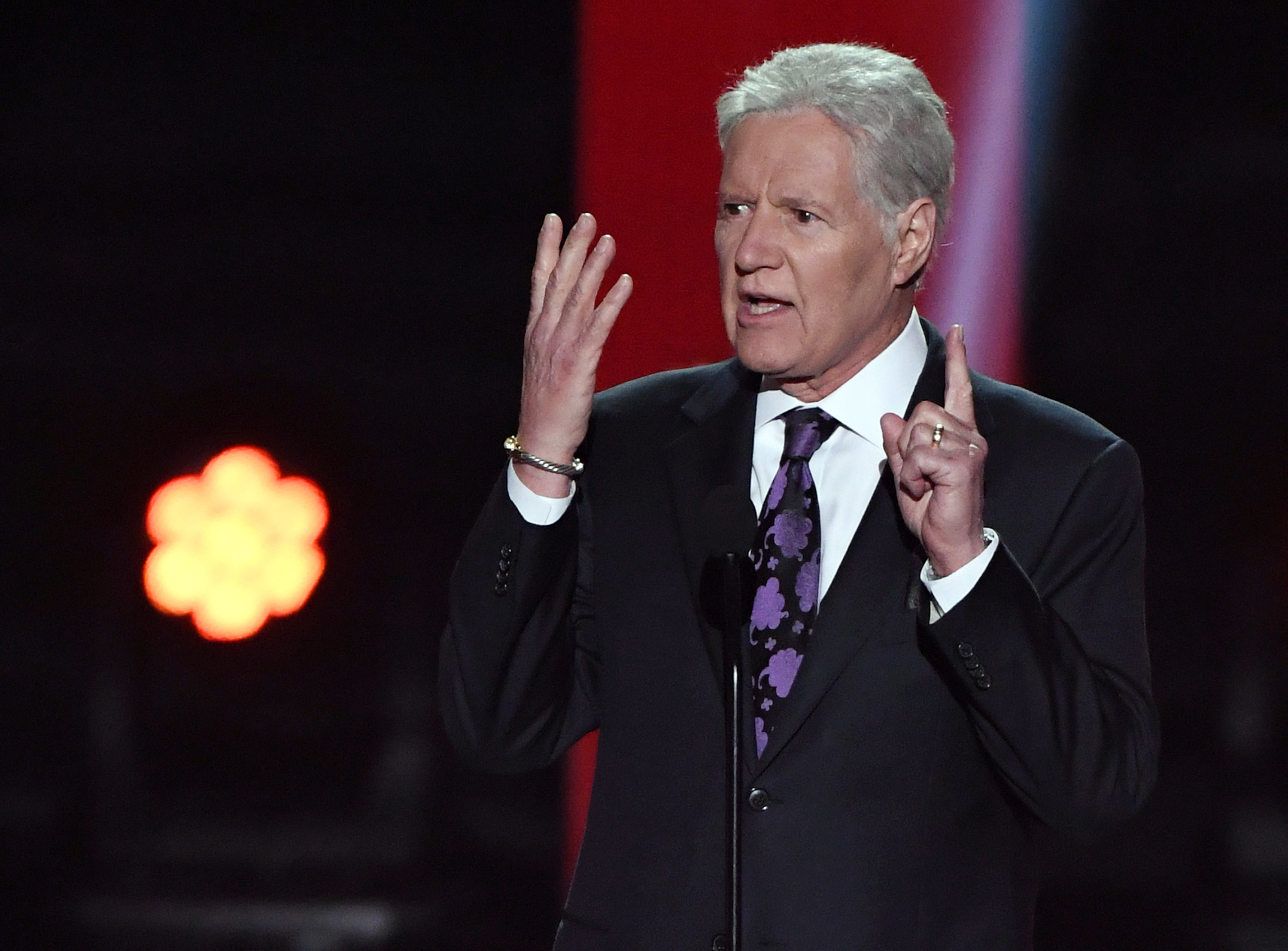 """""""Jeopardy!"""" host Alex Trebek presents the Hart Memorial Trophy during the 2019 NHL Awards"""