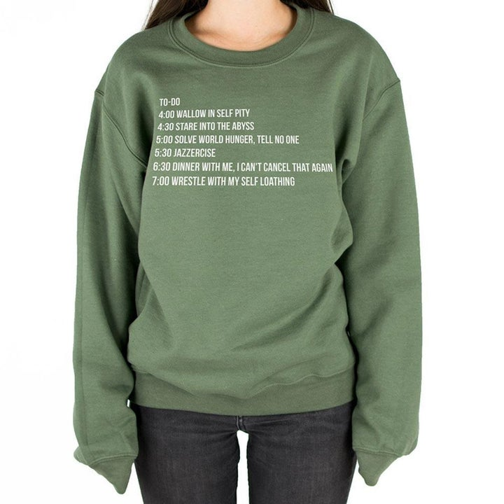 person wearing pullover in light green